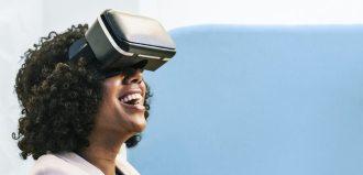 Lady sitting on a chair using Virtual Reality helmet