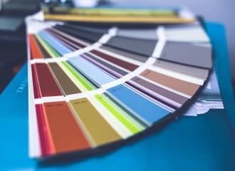 Paint fan deck with a range of different coloured paints