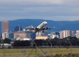 Adelaide airport with a Virgin plane taking off