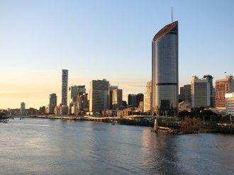 Brisbane city and riser at sunset
