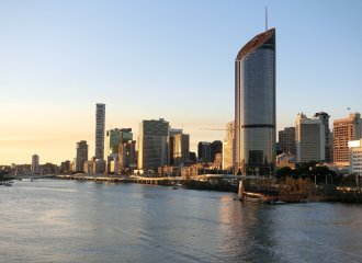 Brisbane city and riser at sunset