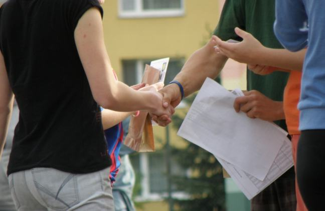 4 people meeting outside a building and shaking hands